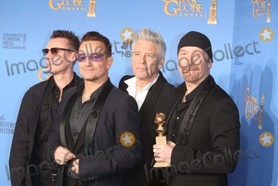 Adam Clayton Photo - Larry Mullen Jr (l-r) Bono Adam Clayton and the Edge of U2 Pose in the Press Room of the 71st Annual Golden Globe Awards Aka Golden Globes at Hotel Beverly Hilton in Los Angeles USA on 12 January 2014 Photo Alec Michael Photo by Alec Michael - Globe Photos Inc