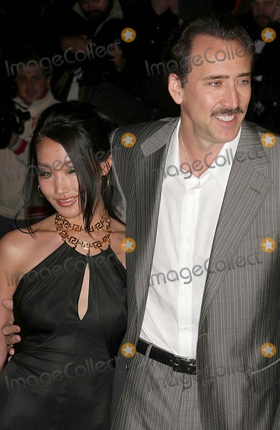 Alice Kim Photo - Donatella Versace Host Cocktail Party to Celebrate the Re-opening of the Versace Boutique on Fifth Avenue  New York City 02-07-2006 Photo John Barrett-Globe Photos Inc 2006 Nicolas Cage Alice Kim