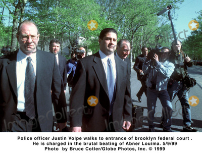Abner Louima Photo - 0999 Police Officer Justin Volpe Walks to Entrance of Brooklyn Federal Court  He Is Charged in the Brutal Beating of Abner Louima Photo Bruce CotlerGlobe Photos Inc