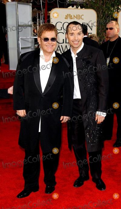 Elton John Photo - 61st Annual Golden Globe Awards Arrivals at the Beverly Hilton Hotel Beverly Hills CA 1252004 Photo by Fitzroy BarrettGlobe Photos 2004 Elton John and David Furnish