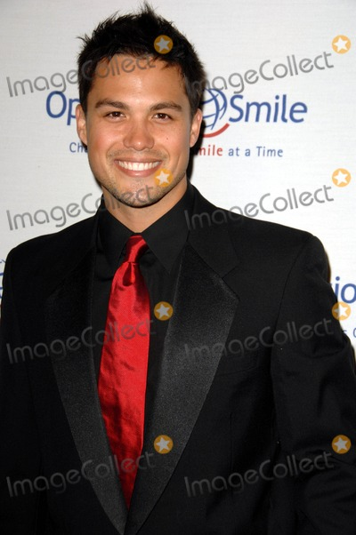 Michael Copon Photo - Michael Copon attends the 9th Annual Operation Smile Gala Held at the Beverly Hilton Hotel in Beverly Hills California on September 24 2010 Photo by D Long- Globe Photos Inc 2010