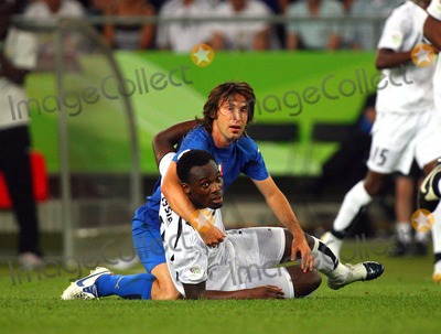 Andrea Pirlo Photo - Italy Vs Ghana 06-12-2006 Hannover Germany Photo by Richard Sellers-Globe Photos Inc 2006 Andrea Pirlo  Michael Essien Challenge