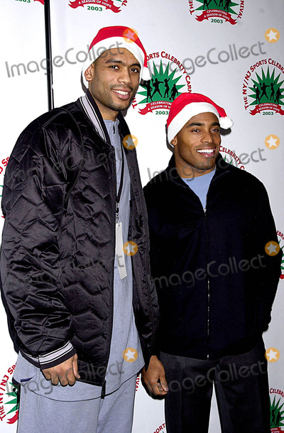 Allan Houston Photo - K34649JKRONNEW YORK GIANTS MICHAEL BARROW HOSTED 2ND ANNUAL NYNJ SPORTS CELEBRITY CARNIVAL AT MADISON SQUARE GARDENPLAY BY PLAY IN NEW YORK CITY12152003PHOTO BYJOHN KRONDESGLOBE PHOTOS INC  2003ALLAN HOUSTON (NEW YORK KNICKS) AND TIKI BARBER (NEW YORK GIANTS)