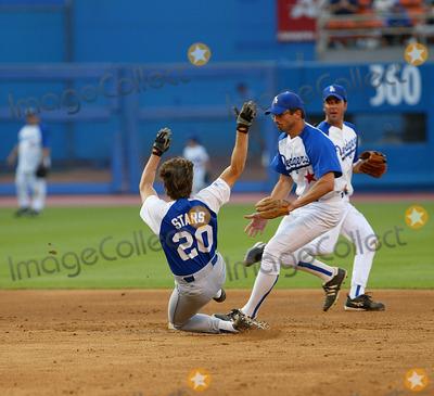 Bryan Cranston Photo - Hollywood Stars Baseball Game at Dodger Stadium in Los Angeles CA Bryan Cranston Slides Into Second Base Photo by Fitzroy Barrett  Globe Photos Inc 8-10-2002 K25794fb (D)