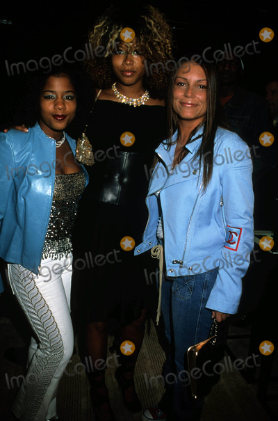 Angie Martinez Photo - Kelis W Sister (L)  Angie Martinez Chanel Opens a New Flagship Boutique70th Anniversary Photo by Sonia Moskowitz-Globe Photos Inc