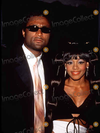 Left Eye Lopes Photo -  Post Grammy Party at Dorothy Chandler Pavilion in Los Angeles 022300 Andre Rison with Lisa Left Eye Lopes Photo by Tom RodriguezGlobe Photos Inc