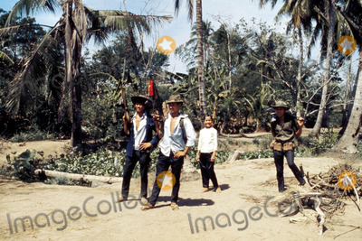 Jeff Taylor Photo - Vietcong in Nlf Village Mekong Delta South Vietnam Carry Nlf Flags Ak47s Photo by Jeff TaylorGlobe Photos