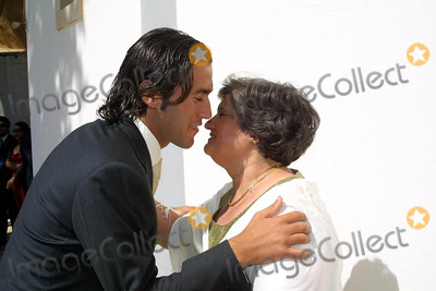 Hugo Viana Photo - 20030628 ALBUFEIRA PORTUGAL Hugo Viana kissing his mother Maria Filomena before marriage cerimony at Orada chapel in Albufeira Algarve The portuguese star of NewCastle 20 invited to his marriage with Raquel Gomes only the family and some close friends as Beto ex-collegue from Sporting Raquel is natural from Armacao de Pera Algarve The honeymoon will be in MaldivasPHOTO CITYFILESGLOBE PHOTOS INCK31480