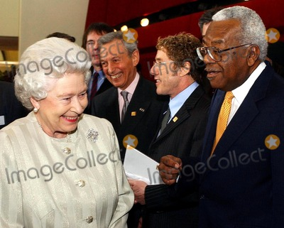 Albert Hall Photo - A14640NO UK RIGHTS UNTIL 30042004054522 03302004The Queen shares a joke with television presenter Sir Trevor McDonald during a visit to the Royal Albert Hall in London marking the end of an 8 year restoration program The overhaul of one of Londons best known landmarks has cost 70 million and includes two new foyers revamped seating in the stalls and circle as well as better access for disabled patrons