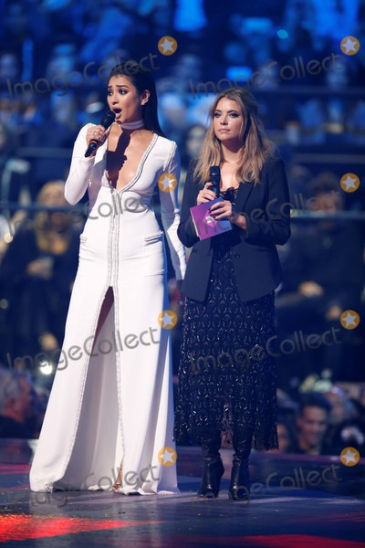 Ashley Benson Photo - Shay Mitchell (L) and Ashley Benson Present an Award at the 2015 Mtv Europe Music Awards Emas at Mediolanum Forum in Milan Italy on 25 February 2012 Photo Alec Michael