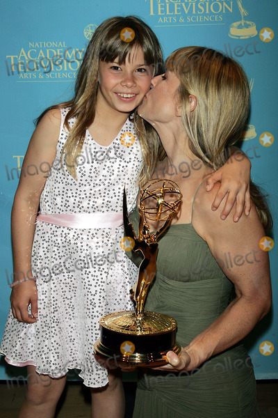 Bindi Irwin Photo - Terri and Bindi Irwin Hold the Emmy Award That Bindi Won For Her Show Bindi the Jungle Girl at the Creative Arts  Entertainment Emmy Awards at Rose Hall at Time Warner Center in New York on June 13 2008 Photo by Terry GatanisGlobe Photos Inc