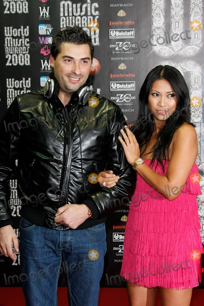 Anggun Photo - Dj Laurent Wolf and Singer Anggun Arriving at the World Music Awards at Sporting Club in Monte Carlo Monaco on November 9th 2008 Photo by Alec Michael-Globe Photos