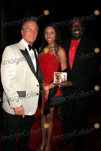 Ali Woodson Photo - 11th Annual Multicultural Prism Awards Gala Sheraton Universal Hotel Universal City CA 12-10-2006 Pat Boonem Guest and Ali Woodson-producer Photo Clinton H Wallace-photomundo-Globe Photos Inc