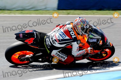 Alex Barros Photo - LISBON PORTUGAL The Moto GP competition race Italian Racer Valentino Rossi won Portugal Moto GP Makoto Tamada (Japan) was second and Alex Barros (Brazil) was third In photo Brazilian racer Alex Barros952004PHOTO ALVARO ISIDOROCITYFILESGLOBE PHOTOS INC  2004K39151