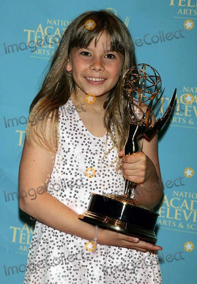 Bindi Irwin Photo - Bindi Irwin Holds the Emmy She Won For Her Show Bindi the Jungle Girl at the Creative Arts  Entertainment Emmy Awards at Rose Hall at Time Warner Center in New York on June 13 2008 Photo by Terry GatanisGlobe Photos Inc