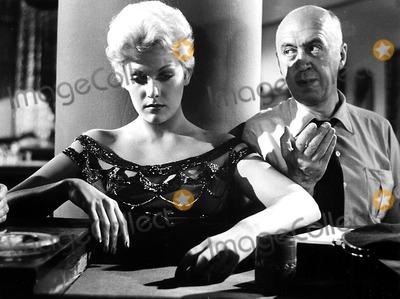 Kim Novak Photo - Kim Novak and Director Otto Preminger on the Set of the Man with the Golden Arm 1955 Supplied by Globe Photos Inc Kimnovakretro