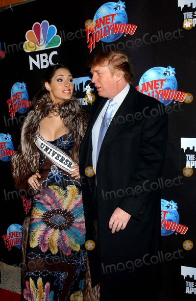 Amelia Vega Photo - the Apprentice Takes Over the Planet Donald Trump and Former Contestants to Attend Viewing Party at Planet Hollywood in New York City 01292004 Photo Ken Babolcsay Ipol Globe Photos Inc 2004 Miss Universe Amelia Vega and Donald Trump Dtrumpmn