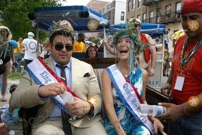 Adam Richman Photo - Coney Island Mermaid Parade Brooklyn NY King Neptune Adam Richman and   Queen Mermaid Cat Greenleaf                                                                                                           Bruce Cotler - Globe Photos                      6  18  11 Adam Richman - Cat Greenleaf