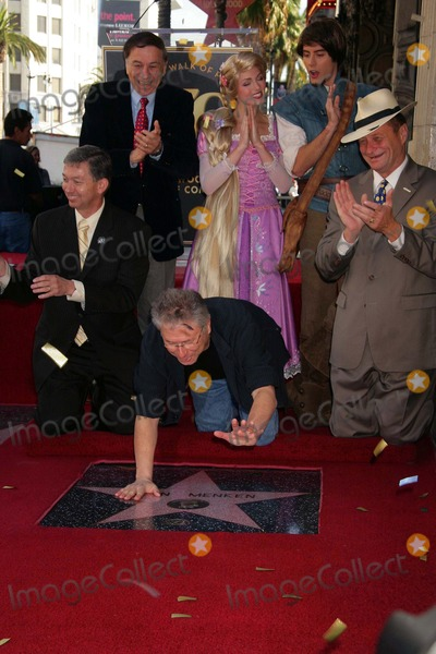 Alan Menken Photo - Composer Alan Menken Honored with Star on the Hollywood Walk of Fame El Capitan Theatre Hollywood CA 11102010 Leron Gubler Richard Sherman Alan Menken Posing with Rapunzel and Flynn Photo Clinton H Wallace-photomundo-Globe Photos Inc 2010