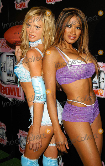 Traci Bingham Photo - - Angie Everhart Nikki Ziering and Traci Bingham Unveils Plans For Lingerie Bowl 2004 - Quixote Studios West Hollywood CA - 06252003 - Photo by Jonathan Friolo  Globe Photos Inc 2003 - Nikki Ziering and Traci Bingham