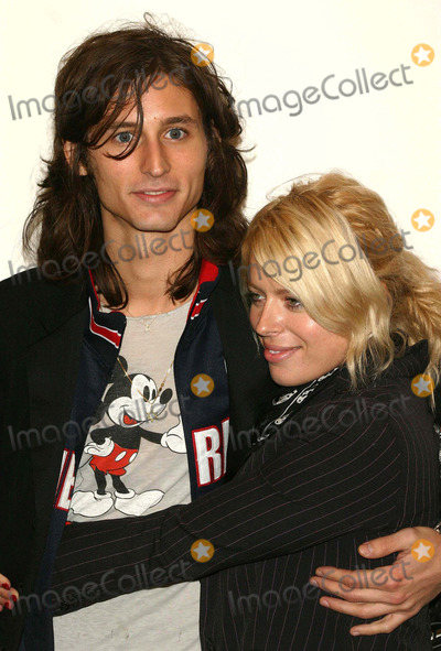 Nick Valensi Photo - The Opening Reception For Anton Corbins Exhibit of U2 Photos at the Stellan Holm Gallery New York City 10-09-2005 Photo by John Zissel-ipol-Globe Photos 2005 Amanda DE Cadenet and Nick Valensi of the Strokes