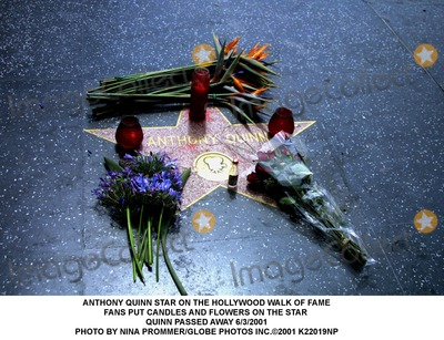 Anthony Quinn Photo - Anthony Quinn Star on the Hollywood Walk of Fame Fans Put Candles and Flowers on the Star Quinn Passed Away 632001 Photo by Nina PrommerGlobe Photos Inc2001