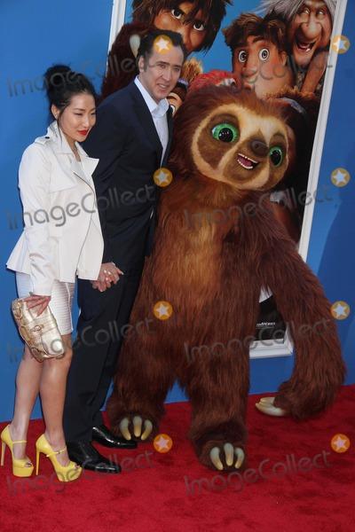 Alice Kim Photo - Nicolas Cagealice Kim Wife at Premiere of the Croods at Amc Loews Lincoln Square W68st 3-10-2013 John BarrettGlobe Photo