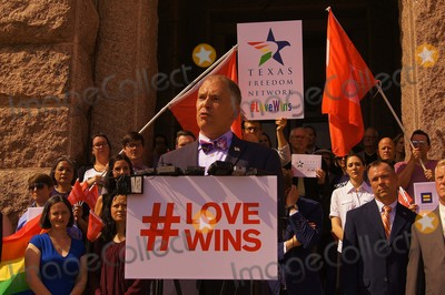 Jim Obergefell Photo - Approximately 150 People Gathered on the North Steps of the Texas State Capitol on 06292015 to Support the Recent Supreme Court Ruling on Gay Marriage and to Protest Recent Statements by Texas State Attorney Ken Paxton and Governor Greg Abbott That Wedding Officials in Texas Could Refuse to Perform Ceremonies For Same Sex Couples If They Held Religious Objection Scotus Plaintiffjim Obergefell Addresses the Crowd and Assembled Mediaphoto by Jeff J NewmanGlobe Photos