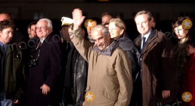 At Last Photo - Iraq hostages Arrived on the French ground  Liberated the 21 Georges Malbrunot and Christian Chesnot are welcomed by the president Jacques Chirac and the prime minister Raffarin  The two journalists at last are met with their near ones  12-22-2004PHOTO BYALFRED CANNAMELA-OMELIAS-GLOBE PHOTOS INC  2004K40953