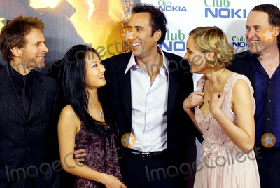 Alice Kim Cage Photo - Jerry Bruckheimer Alice Kim Nicholas Cage Diane Kruger  Jon Turtletaub National Treasure Premiere -Palacio DE LA Musica Madrid Spain 10-26-2004 Photo Byrobert Calanda-globelinkuk-Globe Photos Inc 2004