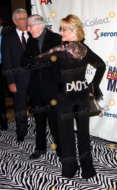 Aaron Spelling Photo - 10th Annual Race to Erase MS Co-chaired by Nancy Davis  Tommy Hilfiger at the Century Plaza Hotel  Spa Century City CA 0592003 Photo by Fitzroy BarrettGlobe Photos Inc 2003 Candy Spelling and Aaron Spelling in Background