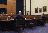 Photo - Christopher Miller of theNational Counterterrorism Center left and FBI director Christopher Wray right sit before chairman Bennie G Thompson   Acting Secretary of HHS Chad Wolfs empty chair indicates a no show at the House Committee on Homeland Security in Washington DC  on September 17 2020 Credit John McDonnell   Pool via CNPAdMedia