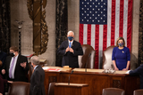 Photo - Speaker of the House Nancy Pelosi D-CA and Vice President Mike Pence look on before a joint session of the House and Senate convenes to count the Electoral College votes cast in Novembers election at the Capitol in Washington Wednesday Jan 6 2021Credit Graeme Jennings  Pool via CNPAdMedia