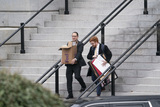 Photos From People carrying paraphernalia depart the Eisenhower Executive Office Building
