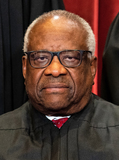 Group Photo Photo - Associate Justice of the Supreme Court Clarence Thomas sits during a group photo of the Justices at the Supreme Court in Washington DC on April 23 2021 Credit Erin Schaff  Pool via CNPAdMedia