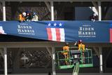 Photo - Workers hang bunting from a media riser for President-elect Joe Bidens inauguration parade outside the White House in Washington DC USA 14 January 2021Credit Jim LoScalzo  Pool via CNPAdMedia