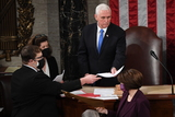 Photo - US Vice President Mike Pence presides over a joint session of Congress to count the electoral votes for President at the US Capitol in Washington DC January 6 2021Credit Saul Loeb  Pool via CNPAdMedia