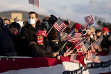American Flag Photo - Supporter of US President Donald Trump wave American flags prior to a farewell ceremony at Joint Base Andrews Maryland US on Wednesday Jan 20 2021 Trump departs Washington with Americans more politically divided and more likely to be out of work than when he arrived while awaiting trial for his second impeachment - an ignominious end to one of the most turbulent presidencies in American history Credit Stefani Reynolds  Pool via CNPAdMedia