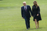 Photos From President Trump Presents  and First Lady Melania Trump Return to the White House