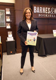 Photos From Kamala Harris Signs Copies Of Her New Book