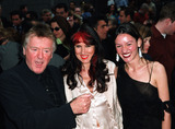 Adrian Lyne Photo - and a belly button  Director Adrian Lyne with his wife Samantha and daughter Amy at the New York premiere of Unfaithful at Ziegfeld Theater New York May 6 2002