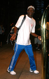 The Cops Photo - Samuel L Jackson seen wearing Call the Cops t-shirt and listening to Apples iPOD as he arrives to his New York hotel Jackson is in town to promote his latest action flick SWAT New York August 4 2003
