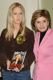 AMBER FREY Photo - NEW YORK JANUARY 10 2005    Amber Frey and Gloria Allred at the Barnes  Noble signing of Witness For the Prosecution of Scott Peterson