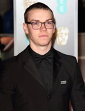 Photo - London UK Will Poulter at EE British Academy Film Awards 2018 - Red Carpet Arrivals at the Royal Albert Hall London on Sunday February 18th 2018 Ref LMK73 -J1591-190218Keith MayhewLandmark Media WWWLMKMEDIACOM
