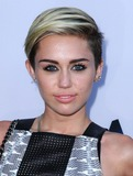 Photo - Miley Cyrus attending the Los Angeles Premiere of Paranoia Held at the Directors Guild of America in Los Angeles California on August 8 2013 Photo by D Long- Globe Photos Inc
